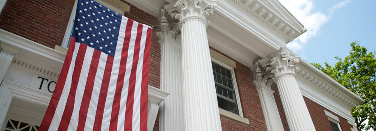 town hall with american flag
