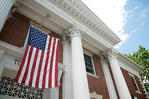 American flag hanging in from town hall building