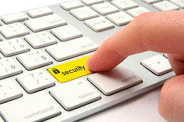 Computer key board with highlighted yellow security key